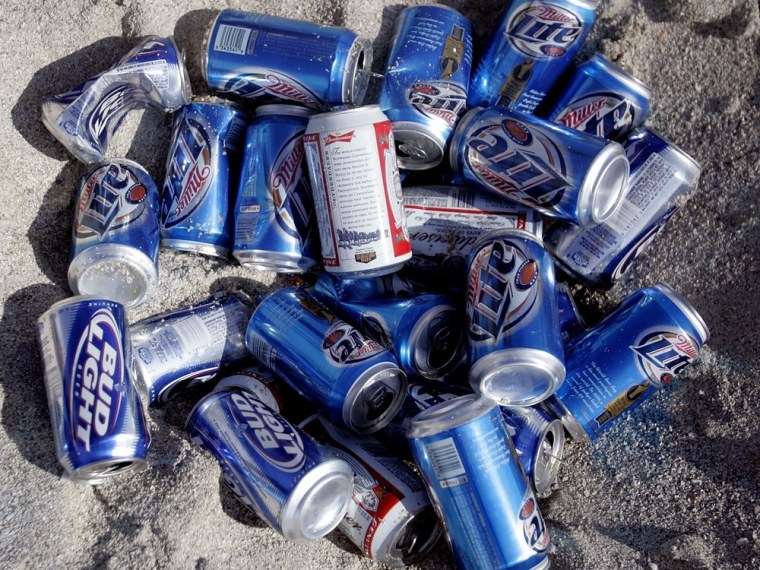 MIAMI BEACH - MARCH 16: A pile of beer cans lays in the sand sun during spring break on South Beach March 16, 2007 in Miami Beach, Florida. Students f...
