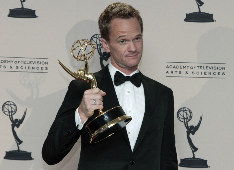 "Neil Patrick Harris poses with the Emmy for Outstanding Special Class Programs for the ""66th Annual Tony Awards"" at the 65th Primetime Creative Arts E..."