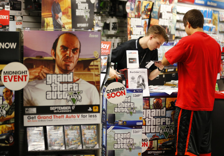 Game enthusiasts purchase the latest release of 'Grand Theft Auto V' at the Game Stop store in Encinitas, California in this file photo taken Septembe...