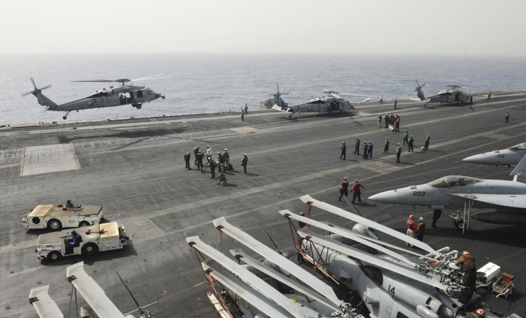 A picture from the US Navy website taken on September 3, 2013 shows MH-60S Sea Hawk helicopters assigned to the Indians of Helicopter Sea Combat Squadron 6 landing on the flight deck of the aircraft carrier USS Nimitz in the Red Sea.