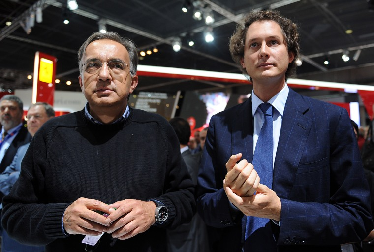 Sergio Marchionne (L), head of carmakers Fiat and Chrysler, and Fiat chairman John Elkann attend a presentation at the Paris Motor Show on September 2...