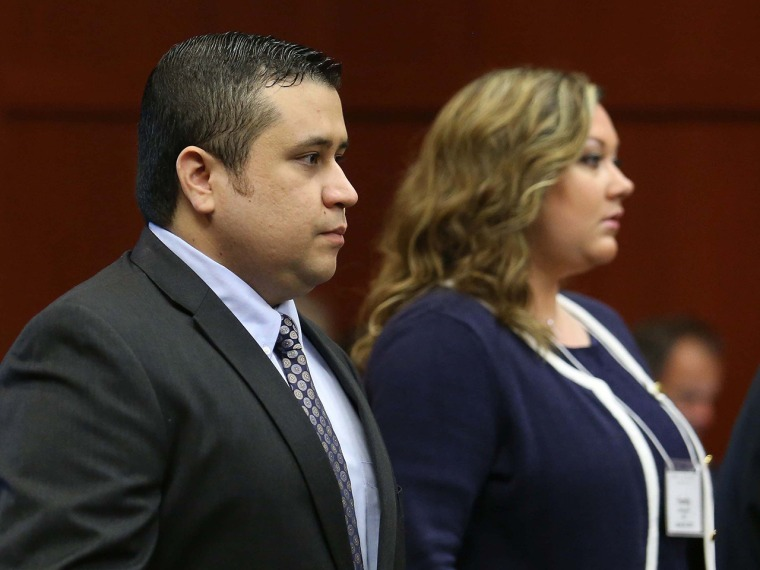 George Zimmerman, left, arrives in Seminole circuit court, with his wife Shellie, in Sanford, Fla., Monday, June 24, 2013. Zimmerman is accused in the...