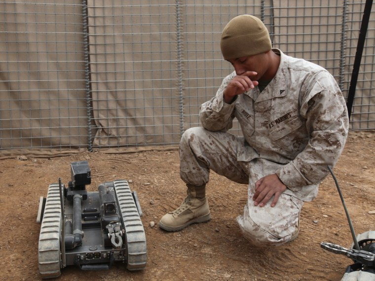 U.S. Marine Corps Lance Cpl. Alfredo Ruiz, assigned to 2nd Combat Engineer Battalion, 2nd Marine Division, briefs fellow Marines and U.S. Sailors on t...