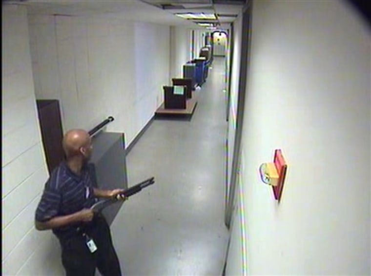 This image from video provided by the FBI shows Aaron Alexis moves through the hallways of a building at the Washington Navy Yard on Sept. 16. He killed 12 people before being shot to death by police.