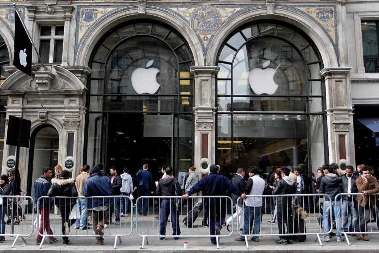 Customers keen to buy the new iPhone 5S, fill the pavement outside the busy Apple store on Regent Street on September 20, 2013 in London, England.