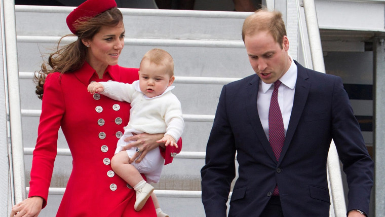 Britain's Prince William, Duke of Cambridge (R) and his wife Catherine, Duchess of Cambridge (L), who carries baby Prince George (C), arri...