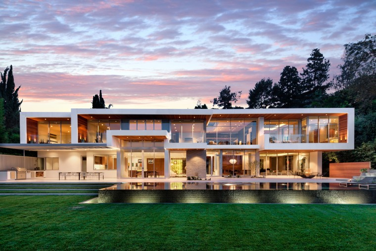 """This L.A. mega-estate has been featured in commercials and is described as a """"resort-like sanctuary"""" with three structures: a main residence, wellness center and guest house."""