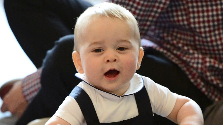 Britain's Prince George plays with a toy at a Plunket play group event at Government House in Wellington, April 9, 2014. Britain's Prince William and ...