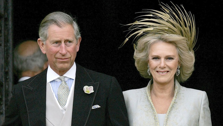 Britain's Prince Charles and his bride Camilla, Duchess of Cornwall leave St George's Chapel in Windsor following the church blessing of their civil w...
