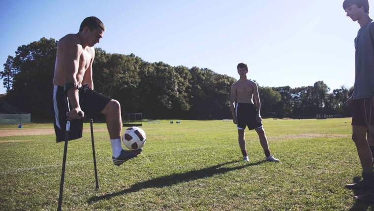 Nicolai Calabria, one-legged soccer player, and school teammates on Sept 19, 2013.