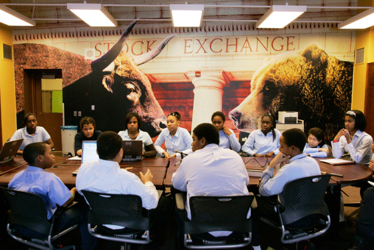 The junior board of directors, elected by seventh- and eighth-graders at the Ariel Community Academy in Chicago, meets to discuss their class holdings in this Feb. 12, 2008, file photo. The public school, established in 1996 by the Chicago-based money management firm Ariel Capital Management, promotes financial literacy and gives kid money to invest.
