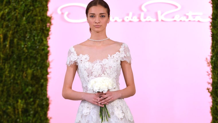 NEW YORK, NY - APRIL 11:  A model walks the runway at the Oscar De La Renta Spring 2015 Bridal collection show on April 11, 2014 in New York City.  (P...