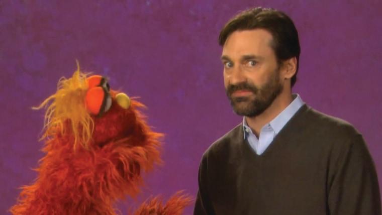 "Image: Jon Hamm with Murray on ""Sesame Street."""