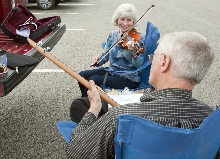 Margaret Byrum of Garland, Texas plays a song on fiddle along with her husband Chuck Byrum on a picking stick in the parking lot outside of the Museum for East Texas Culture earlier this year. New research shows that doing something creative outside of work can help you in your day job as well.