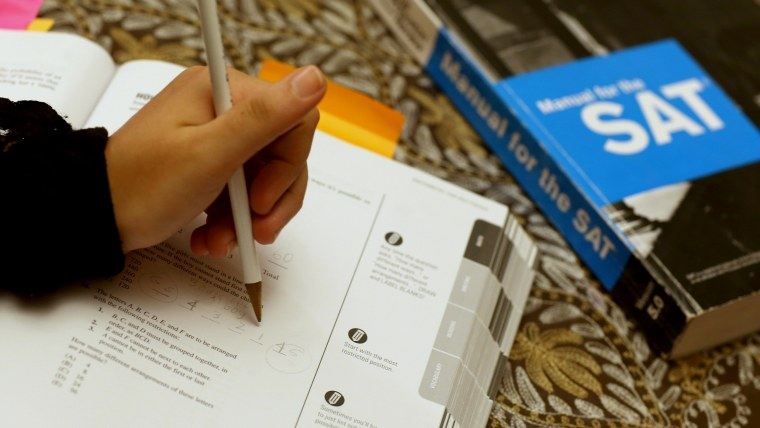 Suzane Nazir uses a Princeton Review SAT Preparation book to study.