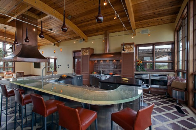Glass countertops can withstand heat and won't stain.