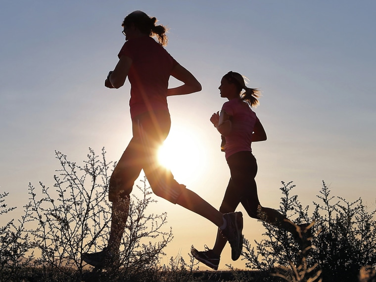 Runners take advantage of lower temperatures at sunrise, Thursday, June 27, 2013 in Mesa, Ariz. Excessive heat warnings will continue for much of the ...