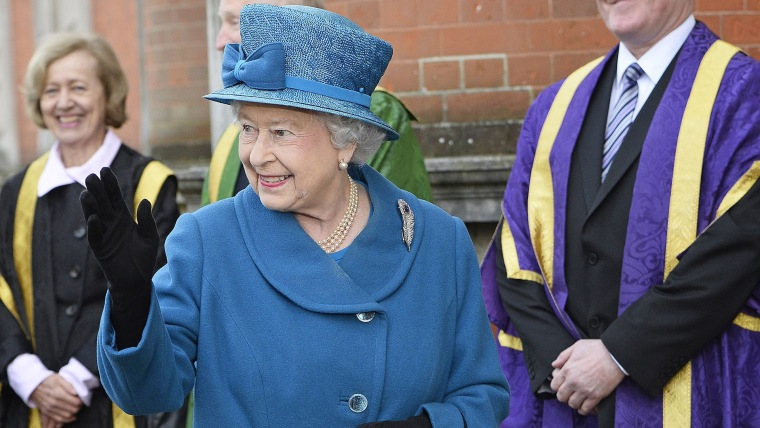 epa04124943 Britain's Queen Elizabeth II arrives at the Royal Holloway University in Egham, Surrey, Britain, 14 March 2014. The University of London c...