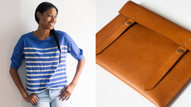 Of a Kind's striped shirt by Calder ($80) and Anza clutch by Louise Goods ($153).