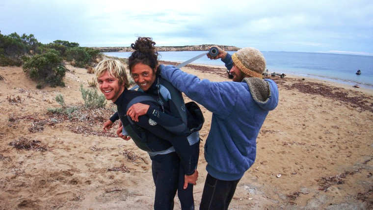 Pascale Honore and Tyron Swan gear up to go surfing.