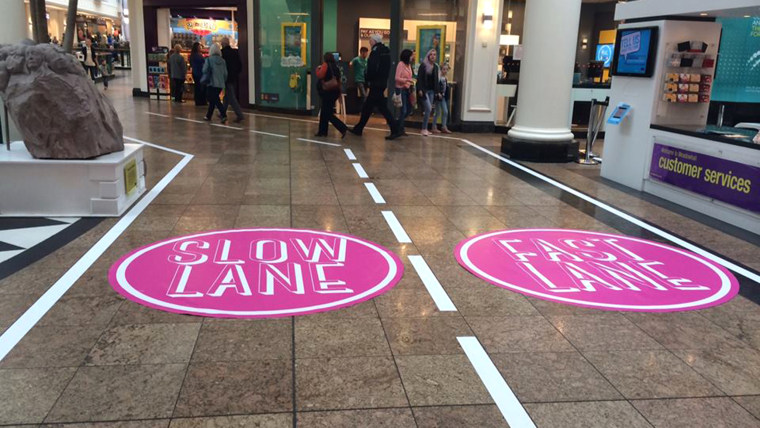 """A British mall has created a """"fast lane"""" and a """"slow lane"""" after getting a letter by a young girl complaining of being stuck behind slow shoppers."""