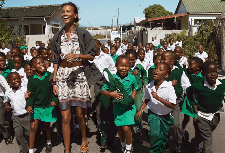Liya Kebede, a designer for the Born Free Collection, with children from Ntwasahlobo Primary School in Cape Town's Khayelitsha township. Fabric desi...