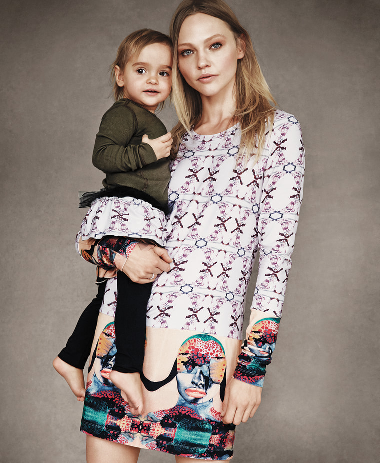 Sasha Pivovarova holding her daughter, Mia, dressed in coordinated outfits by Victoria Beckham for Born Free.