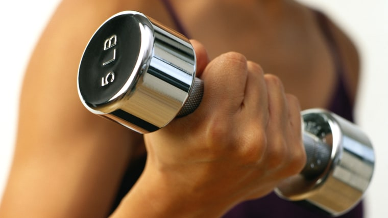 Close-up of a Woman Lifting a Dumbbell Vertical, Indoors, Midsection, Close-up, Human Arm, Caucasian Appearance, Weight Training, Dumbbell, One Person...