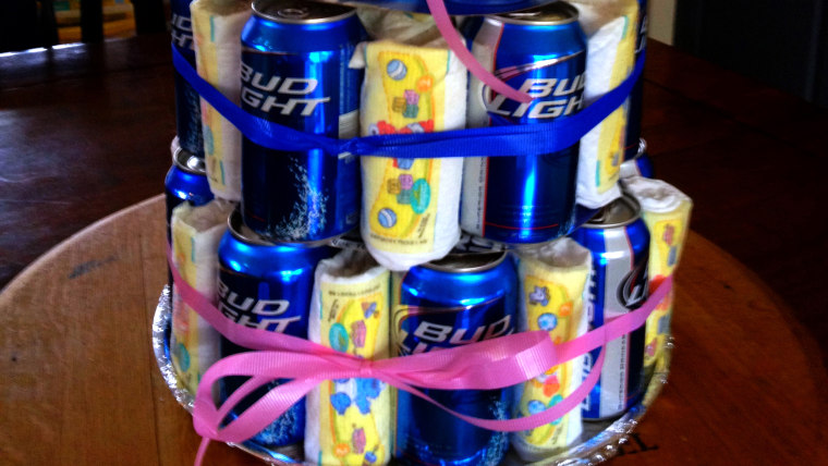 A man shower beer-diaper centerpiece.