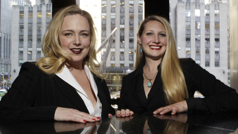 In this Thursday, April 24, 2014 photo, Crystl Faye Horton-Friedman, right, and Kristin Beckler, left, pose for a photo at Del Frisco's in New York. B...