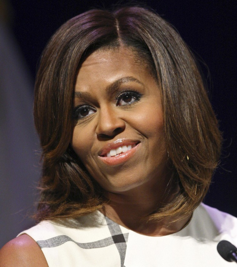 U.S. first lady Michelle Obama gives a keynote speech to the Unite For Veterans Summit in Los Angeles, California, July 16, 2014. Obama is on a two-da...