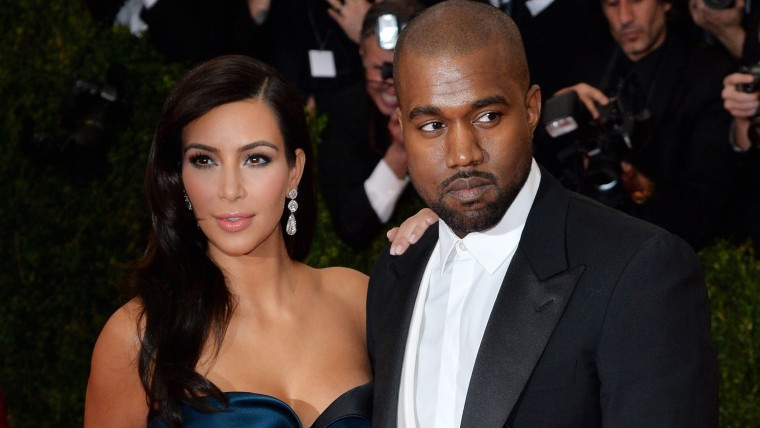 epa04192889 US socialite Kim Kardashian (L) and US singer Kanye West (R) arrive for the 2014 Anna Wintour Costume Center Gala held at the New York Met...