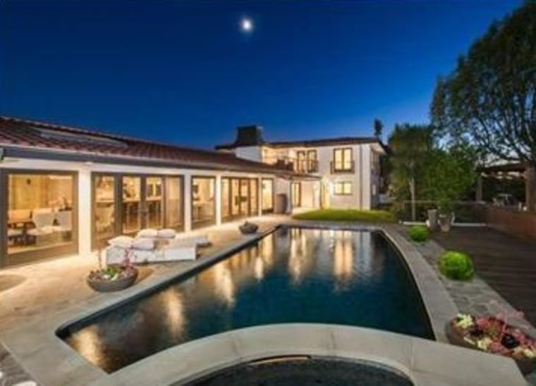 Mila Kunis has listed her home, which features a large entertaining patio around a pool, for $3.995  million.