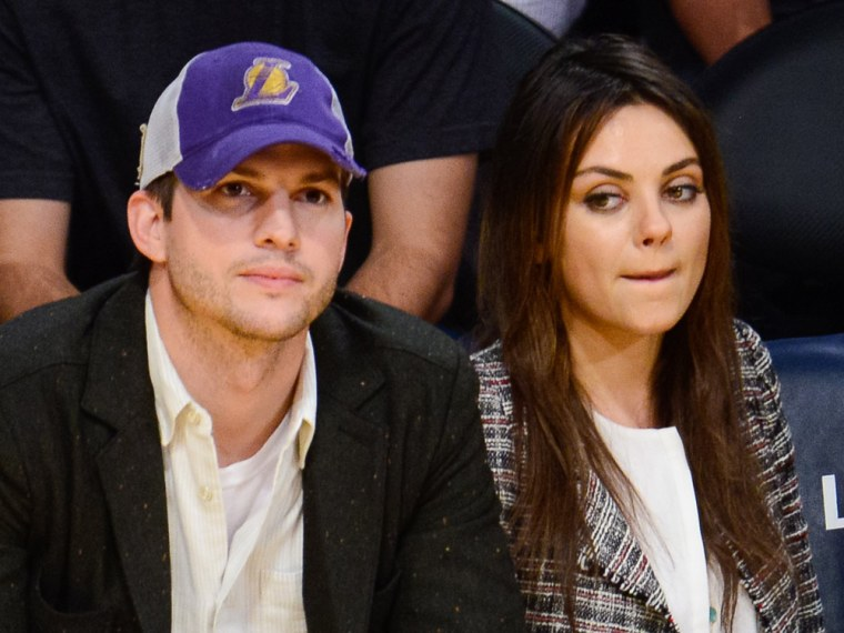Ashton Kutcher and Mila Kunis attend a basketball game between the New Orleans Pelicans and the Los Angeles Lakers at Staples Center on March 4, 2014.