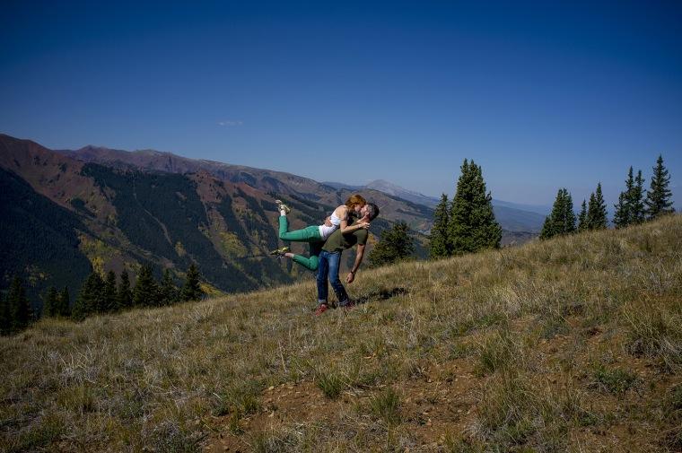 Kissing on a mountain.