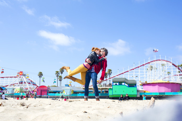 Stopping to kiss at the boardwalk in Santa Cruz, Calif.