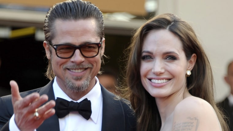 epa04372190 (FILE) A file picture dated 16 May 2011 shows US actors Brad Pitt (R) and Angelina Jolie (L) arriving for the screening of 'The Tree of Li...