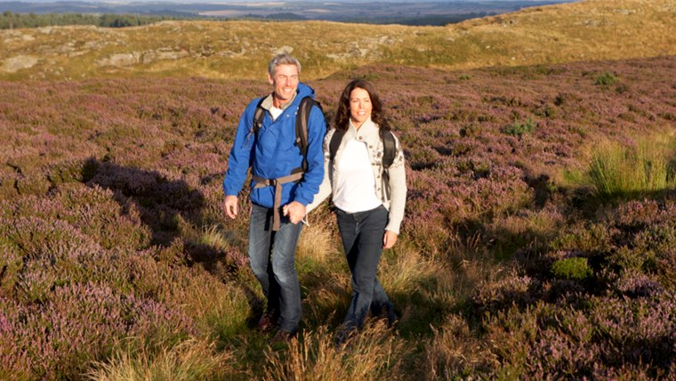 Couple Hiking Across Moorland Covered With Heather; Shutterstock ID 151794929; PO: today.com