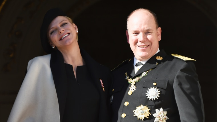 MONACO - NOVEMBER 19:  (L-R) Princess Charlene of Monaco and Prince Albert II of Monaco greet the crowd from the palace's balcony during the National ...