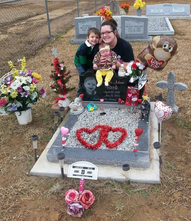 Holly Wagner and her kids at Cameron's grave. Wagner is now working on becoming a certified child passenger safety technician.