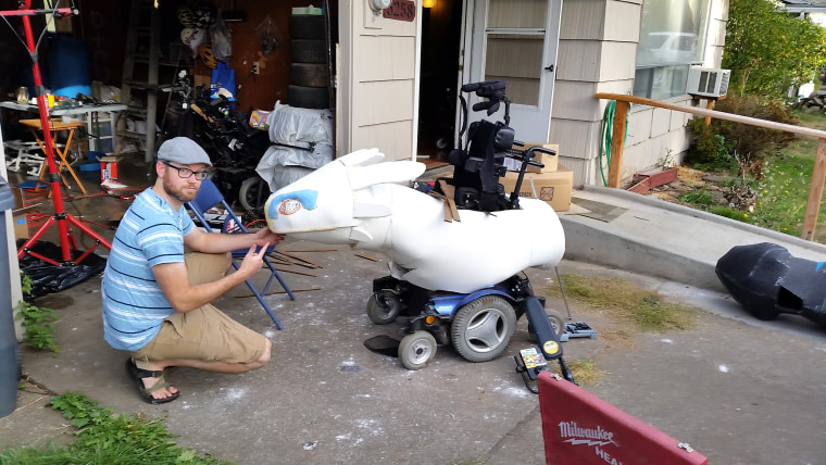 Ryan Weimer assembles a Halloween costume for his son, Keaton, who has muscular dystrophy.