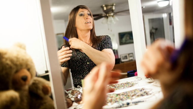 Karen Scot, 56, gets ready at her North Fork, California home before her first day teaching as a transgendered woman at Yosemite High School in Oakhur...