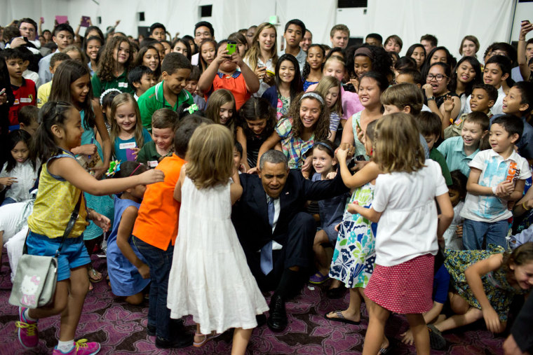 "April 28, 2014 ""'Help me up!', the President beckoned after posing for a photograph with children at the U.S. Embassy in Manila, the Philippines.""  (O..."