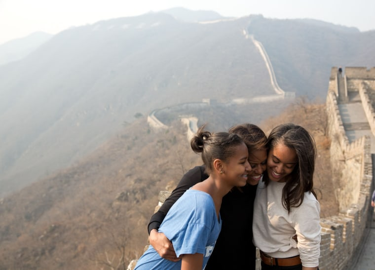 """March 23, 2014 ""A great moment captured by Amanda Lucidon of the First Lady and daughters Sasha and Malia during their visit to the Great Wall of Chi..."