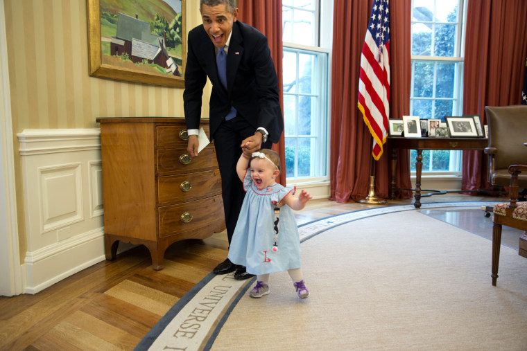 "April 4, 2014 ""Despite the haphazard framing, I love the expressions on the President and one-year-old Lincoln Rose Smith as she learns to walk in the..."