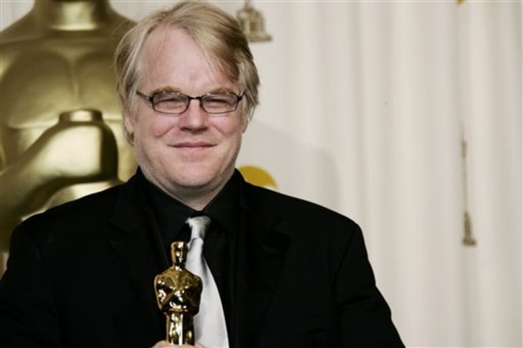 "FILE - In a Sunday, March 5, 2006, file photo, actor Philip Seymour Hoffman poses with the Oscar he won for best actor for his work in ""Capote"" at the..."