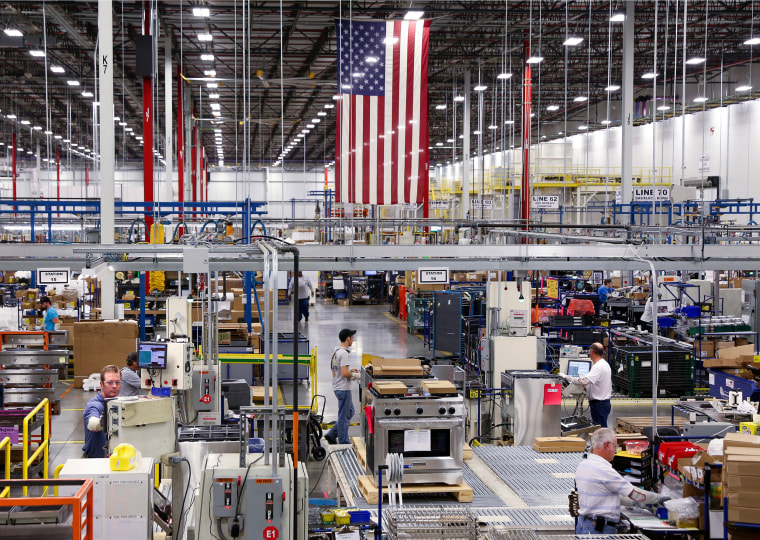 Workers assemble built-in appliances at the Whirlpool manufacturing plant in Cleveland, Tennessee August 21, 2013. The 1-million-square-foot producti...
