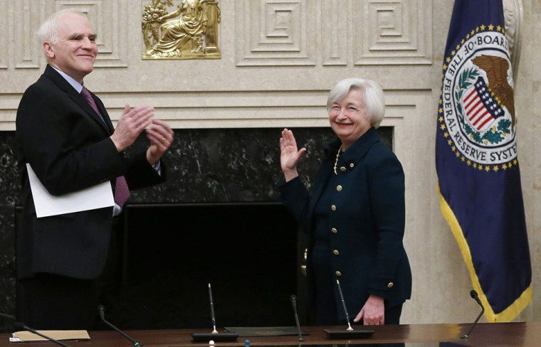 Federal Reserve Board Governor Daniel Tarullo (L) applauds new Federal Reserve Board Chairwoman Janet Yellen after administering the oath of office to...