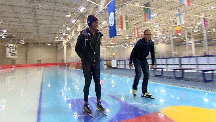 Shani Davis teaches Lester Holt how to speed skate.