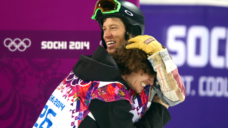 Gold medalist Iouri Podladtchikov of Switzerland embraced Shaun White of USA after becoming the first Olympian besides White to win gold in the halfpipe competition.